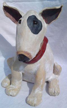 Adorable paper mache dog sculpture.