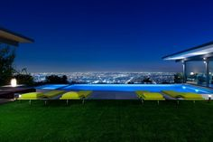 The infinity pool-side furniture is low to the ground,