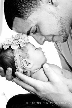 dad and daughter newborn photos precious!