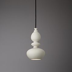 The Nouveau pendant is a marriage of two different but complimentary elements; the simple, modernist 'brandy ballon' shade with an elegant porcelain cast of an Art Nouveau stair case baluster. The combination arose from playful experimentation in the PB studio and resulted in the classically proportioned, contemporary silhouette of the Nouveau pendant.