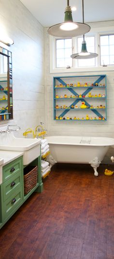 Clean with color pops seems like a great way to go.... white bathroom with blue pops and ducks??
