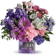 Heart's Delight  If you're looking for a delightful gift that's full of heart, look no further than this beautiful bouquet. A pretty mix of beautiful flowers arranged in a cube vase will express your wishes perfectly.