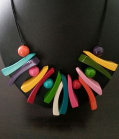 Resin jewelry. Great polymer clay inspiration.