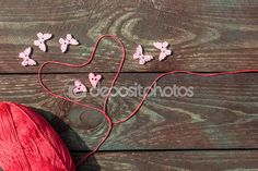 Sewing and knitting. Knitting on a wooden background. Buttons in the form of hearts and butterflies. Postcard love. Hobby. — Stock Photo © NataliaMilekhina #79054300