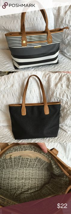 Marc Fisher Handbag This gently used handbag is made of 100 PVC, with cloth interior.  One zipper interior back wall pocket, two interior slip pockets and one exterior small slip pocket ( perfect for a cell phone ). Marc Fisher Bags Satchels