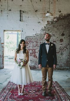 Unique, hipster wedding vibes with a Persian rug contrast with industrial brick background.
