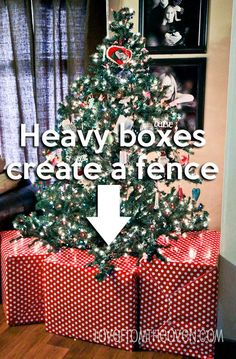 Ideas For Baby, Toddler & Pet Proofing Your Christmas Tree, Home and Decorations.  This is such a great DIY idea, use big boxes to create a fence around the tree.  Won't work if you have a climber, but kept our toddlers and dogs out!