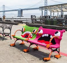 Yarnbombed benches outside the San Francisco Ferry Building.