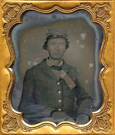 Rare sixth plate ambrotype of a young rebel soldier with a small 1st National Confederate flag jutting out from his coat. More than likely a Virginian as most of the handful of known images posed with this small parade flag are attributed to that state. He's dressed in a grey frock and what was most likely a light blue cap. The small stick to which the flag is mounted is tucked down into his jacket. Piercing blue eyes on this young baby faced rebel. Some solarization to this one as can be…