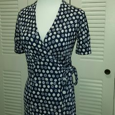"""Lilly  Pulitzer  Navy Squirt  Silk Wrap  Dress Navy Blue & White . Wrap  Dress with Sash Tie At Left Wsist. S/S Knee Length.  100% Silk . Light staining  to armpits, not noticeable. ARMPIT-ARMPIT  16"""" Length  34"""" Lilly Pulitzer Dresses"""