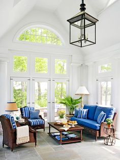 Gorgeous Family Room (or Sun Room) with so many architectural features!!  I love the high vaulted ceiling, the pretty slate floor, the beautiful columns in the corners and the many amazing doors and windows!