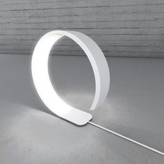 The Pureness lamp contains flexible LEDs. Designed by Simone Savini.
