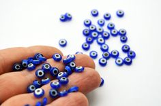 I'd love to make a bracelet with these, they are really cuteeee Blue Evil Eye Flat Glass Beads From Turkey - Set Of Ojo Beads 50 Pcs, Dark Blue Flat Evil Eye Beads Nazar Evil Eye Hamsa Evil Eye Meaning Of Evil, Eye Safety, Safety Pins, Light Blue Color, Dark Blue, Eye Symbol, Baby Shower Supplies, Wholesale Beads, Golden Color