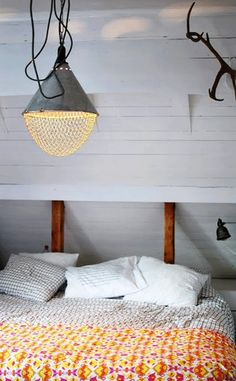 love the bedspread/light combo! Could make the light with a repurposed strainer and hanging shop light