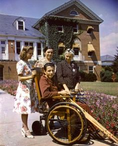 A patient in a wheelchair is shown with his visiting family at Walter Reed General Hospital, in Washington, DC, 1945. (Photo by PhotoQuest/Getty Images)