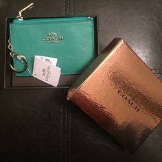 "NEW AUTHENTIC COACH MINI SKINNY WALLET/COIN PURSE Keep for you or Mother's Day is coming up!!!Jade leather with silver hardware, comes with brown and bronze gift box. Original tag still attached. Never used, purchased at Macy's (authentic). embossed with refined texture, the latest Mini Skinny keeps keys, cards and other small essentials secure within its remarkably skinny—and mini—silhouette. Leather Zip-top closure, fabric lining 4 1/2 (L) x 3 1/4"" (H) Packaged in a Coach gift box Style…"