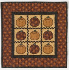It's a patchwork pumpkin patch with ricrac and pumpkin appliques. Quilt pattern by Lynette Jensen of Thimbleberries®. From the book: http://landauerpub.com/Thimbleberries-Quilting-for-Harvest.html