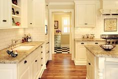 FARMHOUSE – INTERIOR – vintage early american farmhouse showcases raised panel walls, barn wood floor, exposed beamed ceiling, and a simple style for moulding and trim, like in this farmhouse kitchen. Farmhouse Remodel, Farmhouse Interior, Interior Design Kitchen, Kitchen Remodel, Kitchen Designs, Cottage Kitchens, Home Kitchens, Barbie Malibu Dream House, Ranch House Remodel