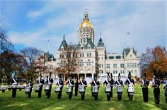 The UConn Drumline performs in front of the state capital at the Connecticut Veteran's Day Parade.
