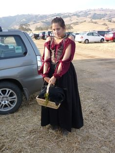 Me at a Renn Faire in 2010.  I've since added layers of skirts and a bigger basket.
