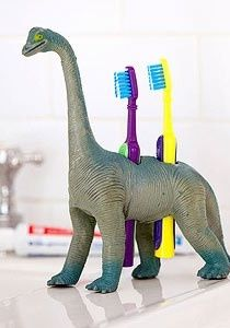 Child friendly bathroom - Drill holes in any plastic toy to make your personal toothbrush holder