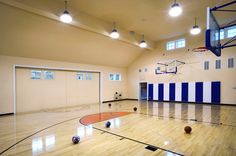 Indoor basketball court on pinterest backyard basketball for Indoor residential basketball court