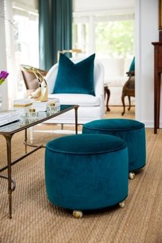 Upholstered stools are on casters for easy movement. Condo Living, Living Room Decor, Sofas, Cane Back Chairs, Living Room Turquoise, Antique Dining Tables, Upholstered Stool, White Furniture, Home Textile