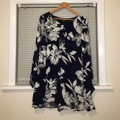 Lulu's Navy and White Floral Dress Long sleeve shift dress with navy and white floral print, never worn. Fits size 6-8 best Lulu's Dresses