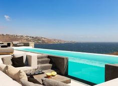 Villa Genesis at Mykonos is available for rent, and located in the prime area of Aleomandra, facing the deep blue waters of the Aegean sea. Villa Genesis is impeccably designed to combine modern style with traditional Mykonian architecture Luxury Villas In Greece, Mykonos Town, Hotel Services, Pool Maintenance, Beautiful Villas, Wood Interiors, Lounge Areas, Night Life, Vip