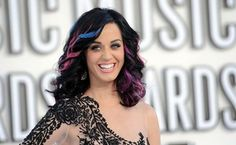 """Katy Perry pulled in $135 million in the past year to be the world's top-grossing musician, beating out Taylor Swift who has hinted at """"bad blood"""" with the fellow pop singer. Forbes magazine said that the 30-year-old Perry, who is on a 150-date world tour for her album """"Prism,"""" narrowly edged out One Direction for income in the year through June 1."""