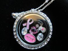 www.JackieMenendez.OrigamiOwl.com www.Facebook.com/OrigamiOwlJackieMenendezRomero  Breast cancer awareness locket.  Contact me to order! JackieMenendez@mail.com 305-323-3319  Tags: Origami Owl, OO, O2, fashion, lockets, Swarovski Crystals, hope, angel   Please note: Image may contain retired items. Please check with the designer.