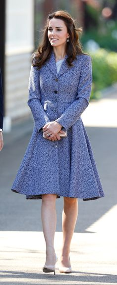 Kate Middleton pairs a Michael Kors swing coat with a Roksanda Ilincic dress while at the opening of a new children's play in West London