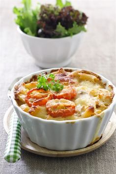Pasta baked with tomato under cheese. Recipe: http://wonderdump.com/pasta-baked-with-tomato/
