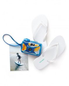 Swimmers will love capturing action shots of friends in  the water with this camera. Outfit your camper with a basic pair of  flip-flops to wear while photographing.Classic flip-flops, similar to shown, $3.94, Old NavyKODAK Sport Single-Use Camera, $11.99, KODAK