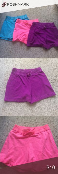 Bundle of lounge shorts Bundle of 3 lounge shorts in purple, pink and blue. They all have an elastic waistband, drawstring tie and are approximately 13 inches across and 12 inches long. No trades. SO Bottoms Casual
