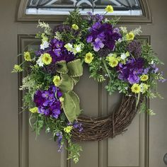 Floral spring wreath purple and green flower wreath on grapevine frame