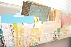 These metal baskets work so well for paper and sticker storage! Hang them on the wall behind your scrapbook table for easy access.    #organization #storage #scrapbook #scrapbooking #creatingkeepsakes
