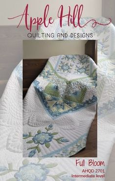 Award winning quilt with applique and pieced block. blue and green
