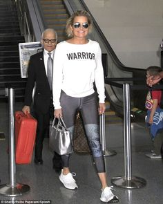 Back in Cali! Yolanda Hadid let her shirt do the talking as she landed at LAX Friday after visiting her three children in Manhattan