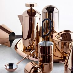 Tom Dixon designs Brew coffee set of reflective copper products. If there is anything more wonderful than coffee itself, this is it!
