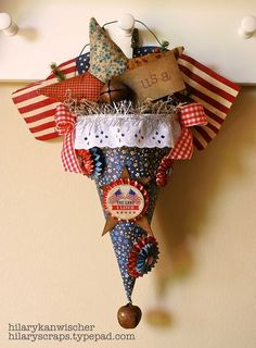 This is a cute Memorial Day/4th of July Decoration. This cone is made from a Sizzix and a few misc. ites. Link to instructions  here.