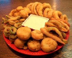 Deep Fried Veggies   deep fried mushrooms, cauliflower, jalapeno slices, green beans, onions rings, red and green bell pepper slices.