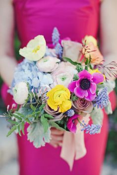 A single hot pink anemone stands out in this bouquet: http://www.stylemepretty.com/2015/07/08/23-gorgeous-wildflower-inspired-bouquets/