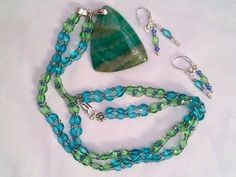 Blue aqua beaded pendant necklace and earrings £12.00