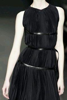 Black pleated dress with bands of leather; elegant fashion details // Prada 2013