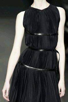 Black pleated dress with bands of leather; elegant fashion details // Prada 2013