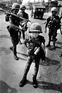 "A ten year old South Vietnamese child soldier, ""called a 'little tiger' for killing two 'Vietcong women cadre' - his mother and teacher, it was rumored."""