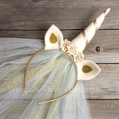 A personal favorite from my Etsy shop https://www.etsy.com/listing/265719856/gold-unicorn-crown-headband-w-tulle-veil