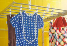 Clothes hanging to dry on GRUNDTAL wall drying rack