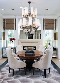 The dining room fireplace is topped with a mirrored wall, but this couple took it to another level, placing a starburst mirror from Z Gallerie on top of it.